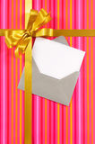 Pink candy stripe Christmas or birthday card with gold gift ribbon and bow and blank card with envelope Stock Images