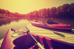 Pink canoes on beautiful lake Cross processed Royalty Free Stock Photography