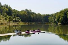 Pink canoes on beautiful lake. Standing Royalty Free Stock Image