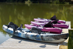 Pink canoes on beautiful lake. Standing Royalty Free Stock Photos