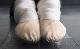Pink Canvas Ballet Dancer Slippers. A Close up of a dancer& x27;s pointed toes in pink canvas ballet slippers Royalty Free Stock Photo