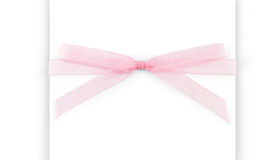 Pink capron ribbon with a bow isolated on white Royalty Free Stock Photography