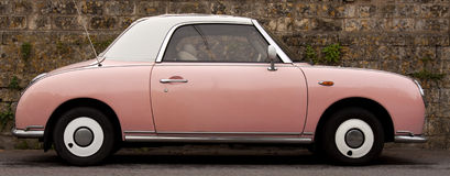 Pink Car. Against a stone wall background stock images
