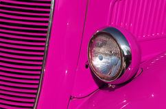 Pink Car. Closeup detail of the headlight of an antique car painted pink Royalty Free Stock Photos