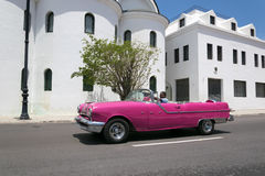 Pink car in Cuba Royalty Free Stock Image