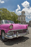 Pink car in Parque Central, Havana, Cuba. An old american car from the 50's, parked in the centre of Old Havana royalty free stock photos