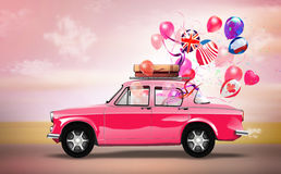 Pink car with symbols of love, holiday, happyness  Stock Photos