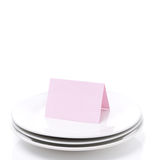 Pink card for congratulation on a plate, isolated Stock Photography