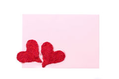 Pink card for congratulation with red hearts, isolated Stock Images