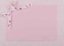 Pink card with decorative ribbon Royalty Free Stock Photos