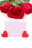 Pink card for greetings, hearts and red roses Stock Image