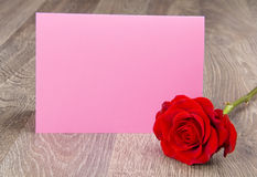 Pink card next to a red rose Stock Images