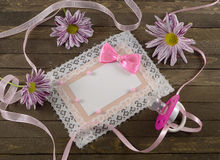 Pink card with pacifier. Pink greeting card with daisy flowers and pacifier Stock Image
