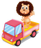 A pink cargo truck with a lion waving at the back Royalty Free Stock Photo