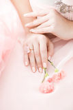 Pink Carnation flower in the hands of a girl on a pink background. Stock Images
