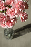 Pink Carnations on Old Wood and Vase Stock Photo