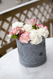Pink carnations on table Stock Photo