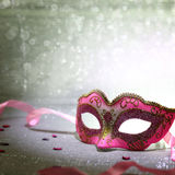 Pink carnival mask. With glittering background stock images