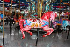 Pink carousel horse Stock Images