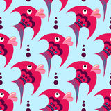 Pink cartoon fish on a blue background. Seamless pattern Stock Photos