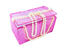 Pink casket and pearl beads Stock Photo