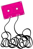 Pink cassette tape. Pink music cassette with jumbled mess of tape below Stock Images