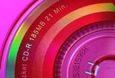 Pink CD. Closeup of a CD stock photography