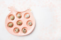Pink ceramic chicken with eggs on soft blurred background. Easter concept Stock Image