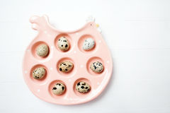 Pink ceramic chiken with eggs on soft blurred background. Easter concept Stock Photos