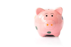 Pink ceramic piggy bank on white background Royalty Free Stock Photo