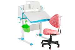 Pink chair, blue school desk, green basket and desk lamp Royalty Free Stock Image