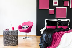 Pink chair in girly bedroom Stock Photography
