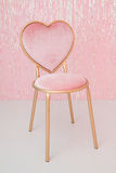Pink chair with heart shape. Ribbon background Royalty Free Stock Photo