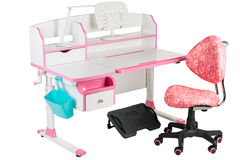 Pink chair, pink school desk, blue basket, desk lamp and black support under legs Stock Photography