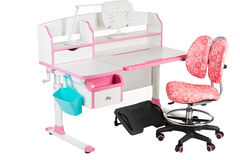 Pink chair, pink school desk, blue basket, desk lamp and black support under legs Royalty Free Stock Photos