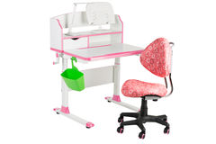 Pink chair, pink school desk, green basket and desk lamp Royalty Free Stock Images