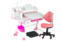 Pink chair, pink school desk, pink basket, desk lamp and black support under legs Stock Photos