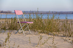 Pink chair on sand Royalty Free Stock Photos