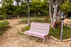 Pink chairs in the garden. Royalty Free Stock Image