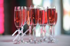 Pink champagne glass. The table in the restaurant. A glass of pink champagne close-up stock photos