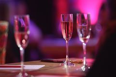 Pink champagne glass. The table in the restaurant. A glass of pink champagne close-up stock photography