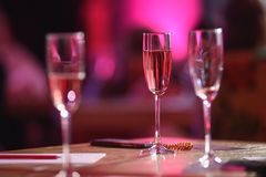 Pink champagne glass. The table in the restaurant. A glass of pink champagne close-up stock photo