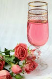 Pink champagne and  pink roses Stock Photography