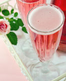 Pink Champagne With A Rose Stock Images