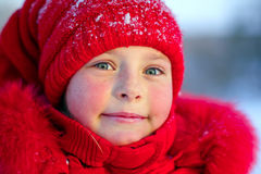 The pink-checked girl in red hat Royalty Free Stock Photos