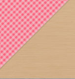 Pink Checkered Tablecloth on Light Brown Wooden Table. Background Royalty Free Stock Photos