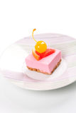 Pink cheesecake with maraschino cherry Royalty Free Stock Image