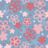 Pink Cherry Blossom Seamless Pattern on Blue Background. Sakura Wallpaper Royalty Free Stock Photo