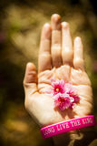 Pink cherry flower on hand with wristband Royalty Free Stock Photography