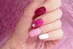 Pink cherry nail design. Pink cherry nail design for nail glitter different shapes closeup royalty free stock images